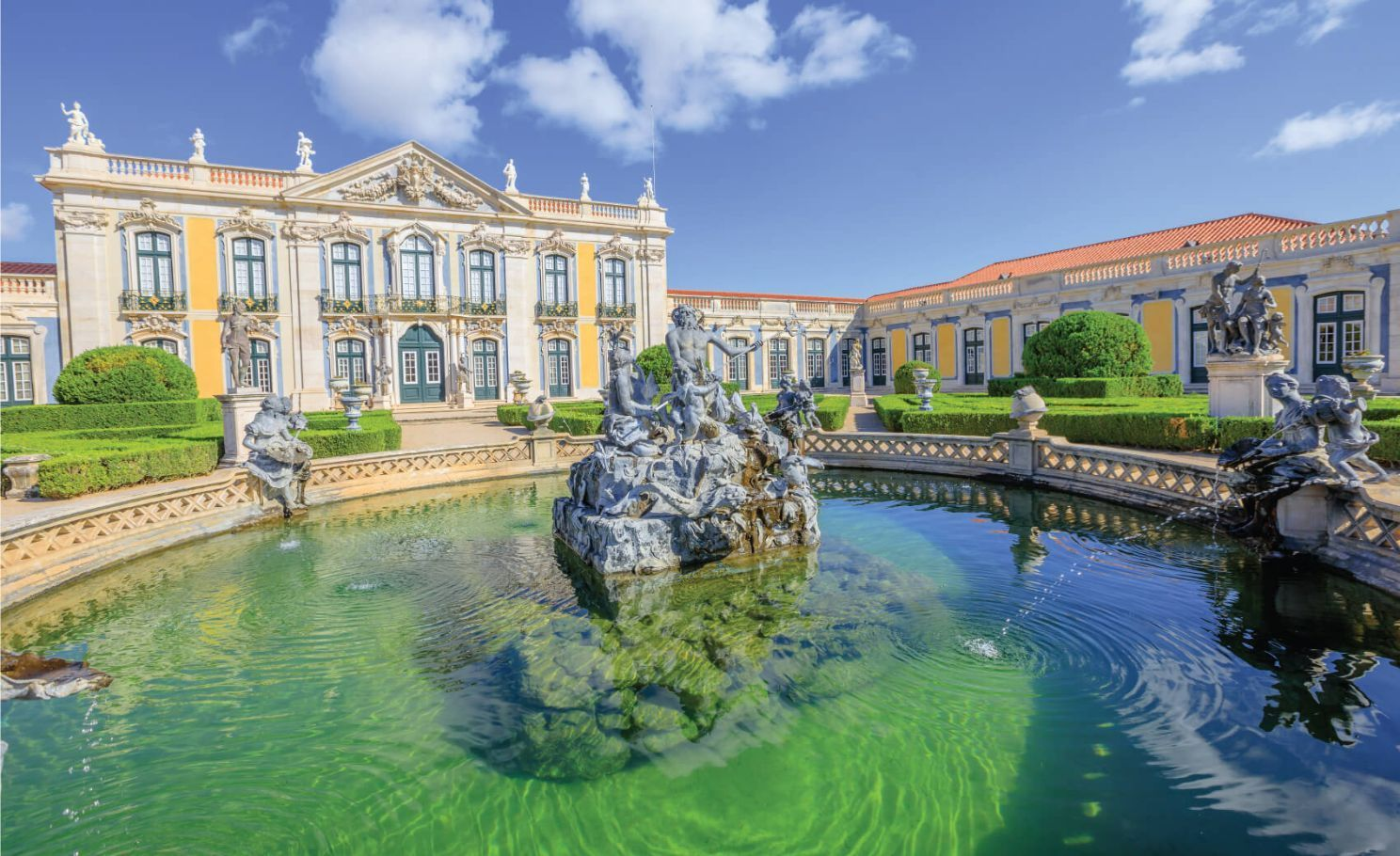 Baroque facade of Queluz National Palace and Neptune Fountain in Sintra, Lisbon district. Defined as