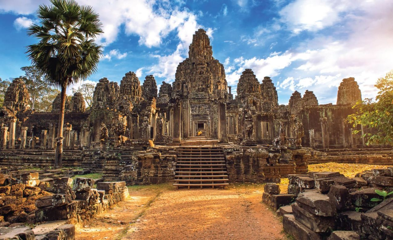 Ancient stone faces at sunset of Bayon temple, Angkor Wat, Siam Reap, Cambodia