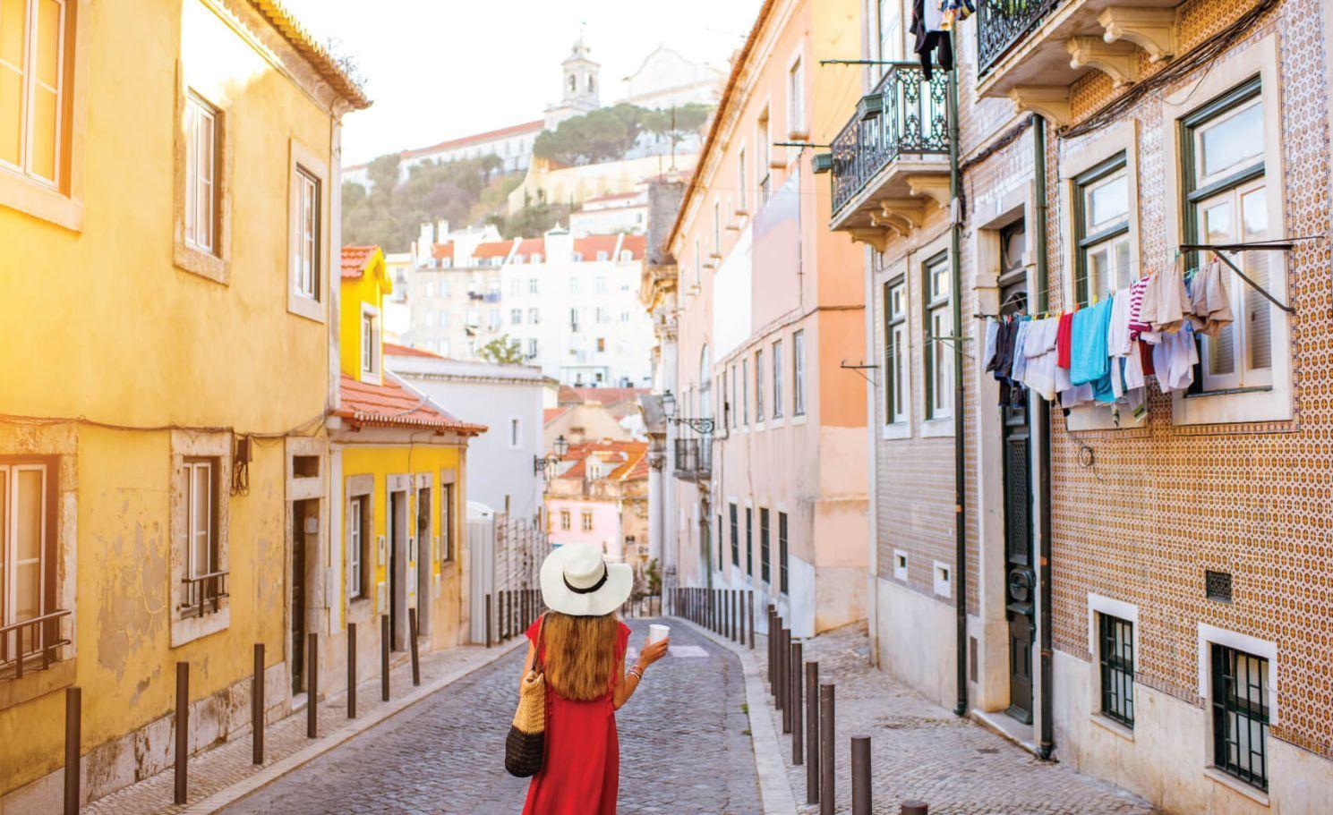 City walk in Alfama region during the morning light in Lisbon