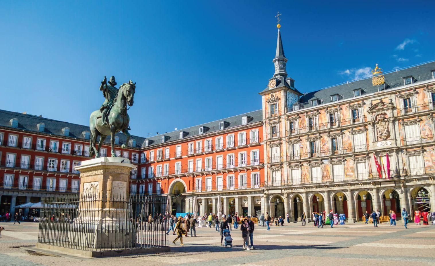 Felipe III statue and Casa de la Panaderia on Plaza Mayor in Madrid, Spain